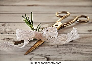 Scissors with rosemary and lace