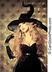 horror - Charming halloween witch over vintage background.