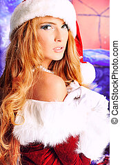 maiden - Beautiful young woman in Santa Claus clothes over...