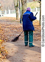 Sweeping - Road Sweeper cleaning walkway in public park from...