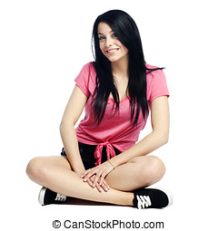 Happy and confident young woman sitting cross legged smiling