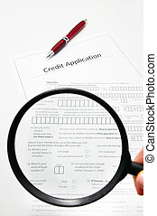a blank credit application and magnifying glass