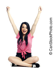 Happy and confident young woman excited with arms up