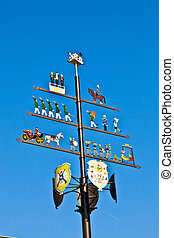 traditional maypole with clear blue sky