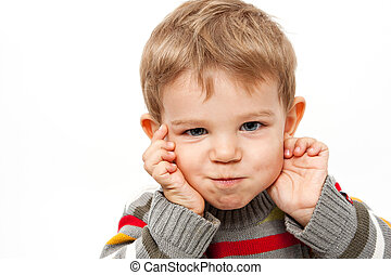 Cute kid making a funny face - Cute kid isolated on white...