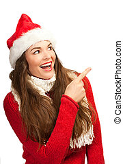 Woman in santa hat pointing to copyspace