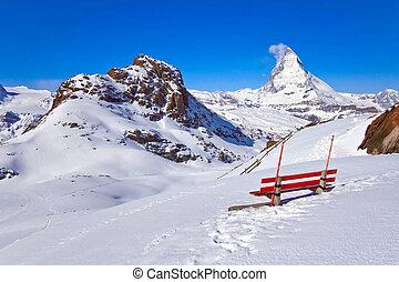 Matterhorn peak Alp Switzerland with red chair - Landscape...