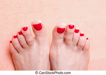 woman feet with red toenails on towel - woman feet with red...
