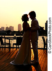 Romantic Couples - Silhouette of Bride and Groom kissing on...