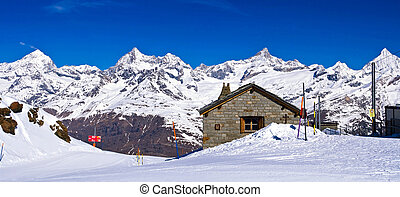 Panoramic view of Swiss alps with Train Station located at...