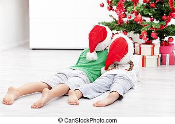 Kids admiring the christmas tree