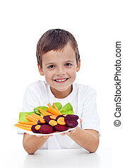 Healthy boy with fresh vegetables on plate - beetroot and...