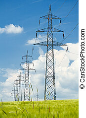 high voltage power lines against a blue sky - high voltage...