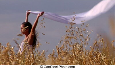 Woman in wheat - Close-up of wheat and woman enjoying warm...