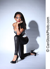 African american woman in leggings and stilettos - Sexy...