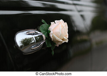 Decorated door of the wedding limousine - Decorative flower...