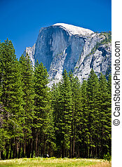 famous rock formation half Dome in the romantic valley of...