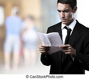 business man with contract - portrait of a handsome young...
