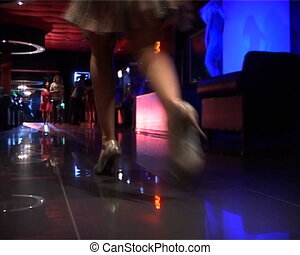 Lady in night club - Close-up of lady steps over floor in...