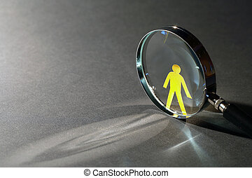 Under Observation - Yellow paper man near magnifying glass...
