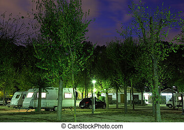 Mobile homes at a camping site at night