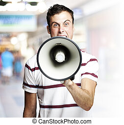 young man shouting - portrait of young man shouting using...
