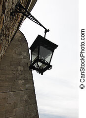 old lantern - old metal lantern on the castle wall