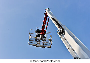 white hydraulic construction cradle against the blue sky