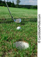 Golf club: ball close to the 18th hole - Golf club: ball...