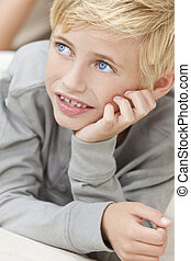 Blond Hair Blue Eyes Boy Child Resting on His Hands - A...