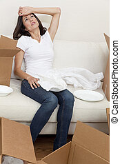 Single Woman Tired Unpacking Boxes Moving House - A...