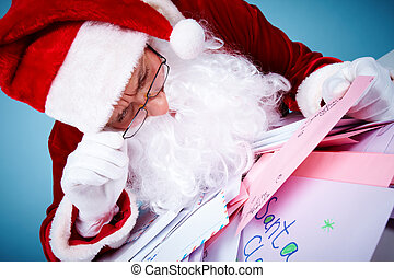 Curiosity - Image of Santa Claus in front of heap of letters...