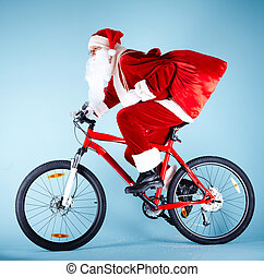 Santa on bike - Photo of Santa Claus with red sack riding...