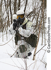 armed men in a camouflage play a paintball