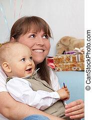 Happy mother with joy kid.