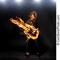 playing rock music - woman is playing rock music on fiery...
