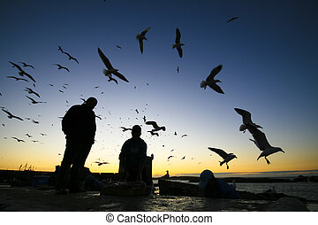 Fishermans in Essaouira, Morocco - Silhouettes of fishermans...