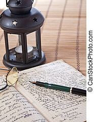 old letter - Antique black candlestick, candle and old...