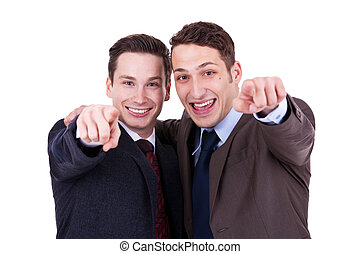 businesss men pointing to you - two happy businesss men...