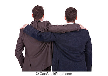 rear view of two young business men friends, over white...