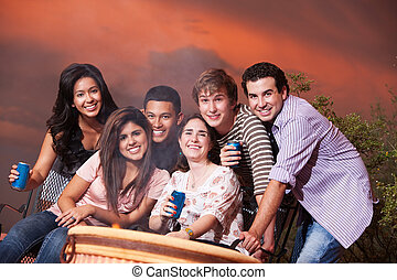 Friends at a Cookout - Group of six happy friends with...