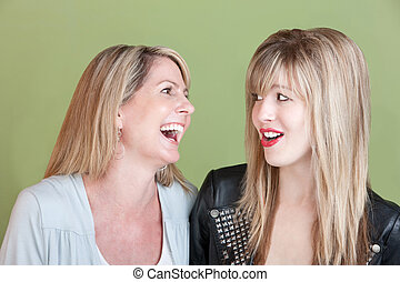 Happy Mother and Daughter - Caucasian mom with retro-styled...