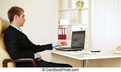 Businessman looking at the camera - Business people