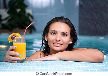 Young beautiful woman in jacuzzi - Young beautiful woman...