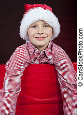 smiling christmas boy in present box