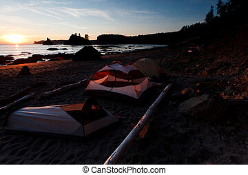 Tents on the beach at sunset