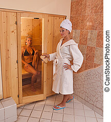 infrared sauna - A infrared sauna cabin with two sexy womans
