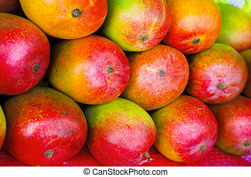 mango fruits - lot of red fresh mango fruits background