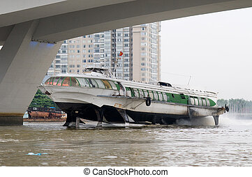 Hydrofoil boat on Saigon River - Hydrofoil boat under a...