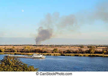 conflagration smoke seen on horizon line from distance